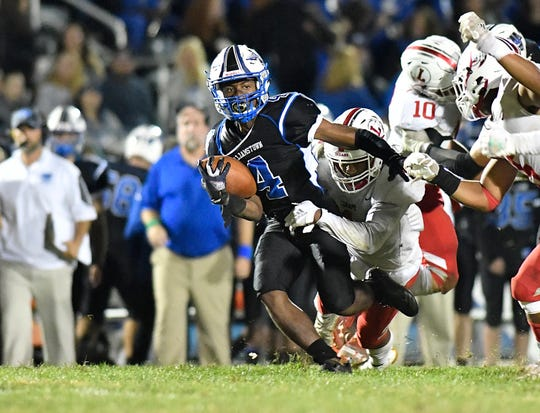 Williamstown's Chris Forman runs for a gain during Friday night's football game against Lenape at Williamstown High School, Sept. 27, 2019.