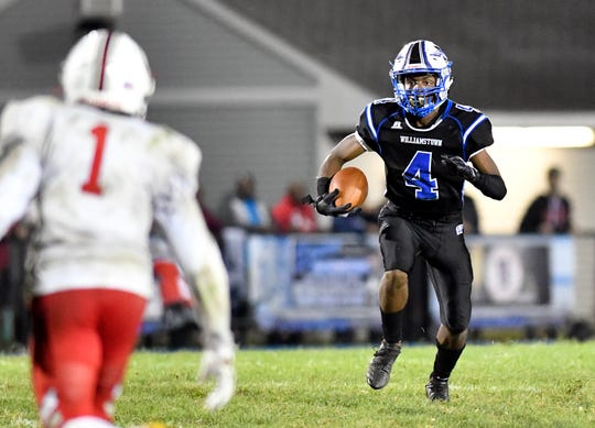 Williamstown's Chris Forman runs for a gain during Friday night's football game against visiting Lenape. The Braves topped the Indians, 28-21, on Sept. 27, 2019.