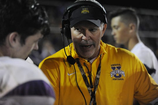 Unioto head coach Jeff Metzler talks to players during a game against Adena on Friday, September 27, 2019 in Frankfort, Ohio. After coaching the program for five years and leading them to three playoff appearances, Jeff Metzler has resigned as the Unioto head football coach.
