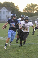 Adena quarterback Preston Sykes runs the ball during a 28-21 win over Unioto on Friday, September 27, 2019 in Frankfort, Ohio.