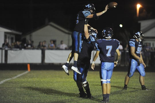 Adena running back Nate Throckmorton celebrates after scoring a touchdown in a 28-21 win over Unioto on Friday, September 27, 2019 in Frankfort, Ohio.