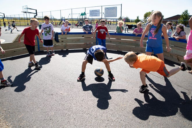 A group of students play in the newly added Gaga pit as part of a program for sixth-grade students that allows them to spend a few days at a camp where they develop leadership, interpersonal and communication skills at Adena Local Schools on Sept. 25, 2019.