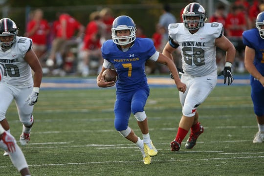 Madeira quarterback Samuel Autry (7) carries the ball during the game against Indian Hill Sept. 27, 2019.
