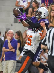 Joe Royer of Elder catches the ball over a Ryle defender for a touchdown at Elder High School, Sept. 27, 2019.
