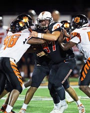 Anderson defensive lineman Tanner Shirley, No. 97, attempts to fight off the block of Withrow lineman Deondre Woolens, No. 56.