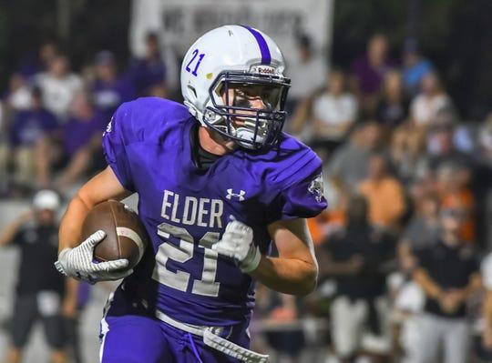Elder Panthers running back Joseph Catania runs the ball against the Ryle Raiders at Elder High School, Friday September 27, 2019