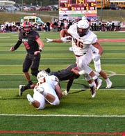 Reece Evans (16) of Turpin breaks tackles on his way to a Spartan touchdown, Sept. 27, 2019.