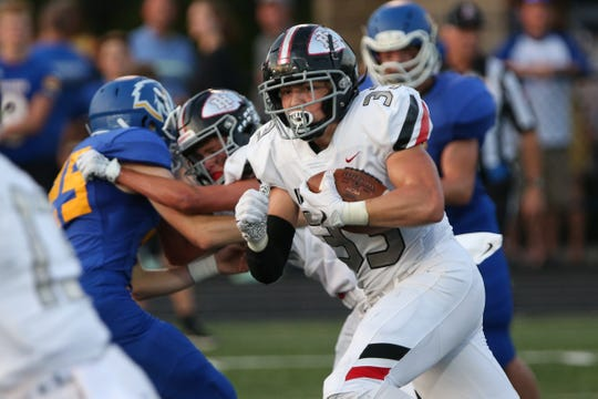 Indian Hill running back Charlie Sumerel (33) carries the ball during the game against Madeira Sept. 27, 2019.