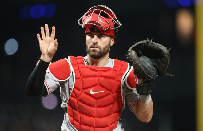 Sep 27, 2019; Pittsburgh, PA, USA;  Cincinnati Reds catcher Curt Casali (12) asks for a new baseball from the umpire against the Pittsburgh Pirates during the fourth inning at PNC Park. Mandatory Credit: Charles LeClaire-USA TODAY Sports