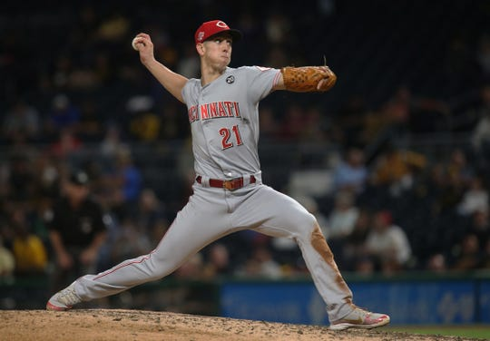 Sep 27, 2019; Pittsburgh, PA, USA;  Cincinnati Reds relief pitcher Michael Lorenzen (21) pitches against the Pittsburgh Pirates during the eighth inning at PNC Park. Mandatory Credit: Charles LeClaire-USA TODAY Sports