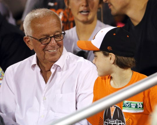 Marty Brennaman chats with young fan Ben Hartong, age 12, at the high school football game at Anderson High School Friday, September 27, 2019.