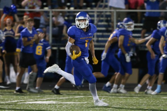 Madeira wide receiver Lee Megois (1) catches a 98-yard touchdown pass during the game against the Indian Hill Sept. 27, 2019, at Madeira.