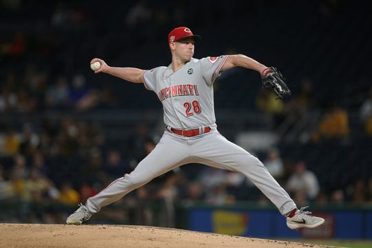 Sep 27, 2019; Pittsburgh, PA, USA;  Cincinnati Reds starting pitcher Anthony DeSclafani (28) delivers a pitch against the Pittsburgh Pirates during the first inning at PNC Park. Mandatory Credit: Charles LeClaire-USA TODAY Sports