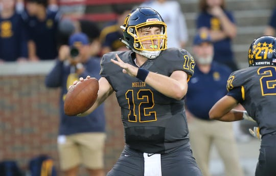 Moeller quarterback Drew Altemuehle drops back to pass during the Crusaders' 24-27 loss to St. Xavier , Friday, Sept. 27, 2019.