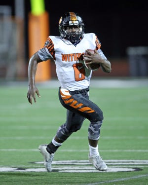 Withrow quarterback Daniel Ingram runs the ball for a first down.