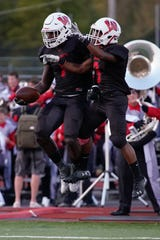 Lakota West running back David Afari (1) celebrates a touchdown reception with running back Malcom Rencher (9) during Friday night's home varsity football match against Fairfield. Fairfield won the game 33-7.