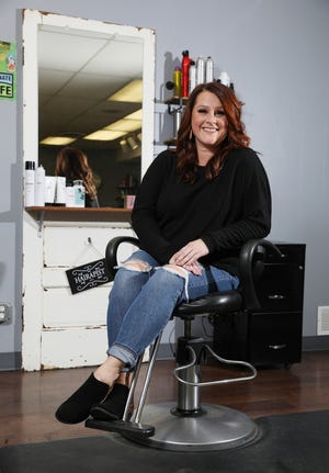 Morgan Hammond owns Split Ends Hair Salon in Coshocton.