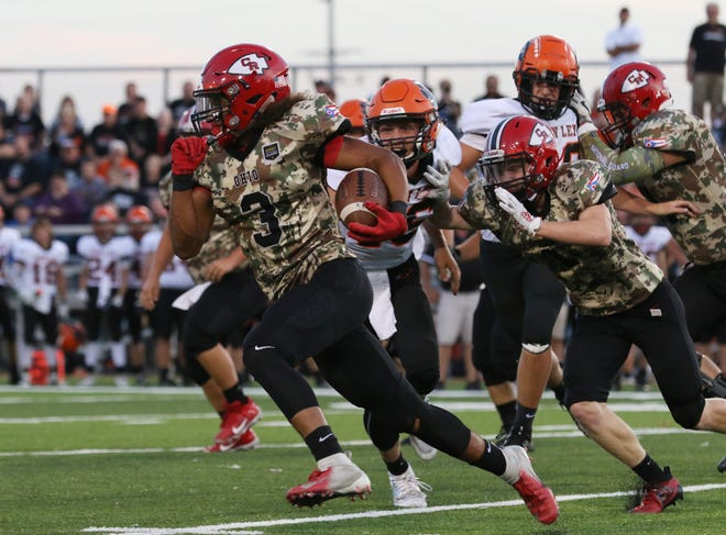 Coshocton's Braydon Johns carries the ball against New Lexington last season. Johns will be a focal point on offense and defense for first-year coach Steve Smith.