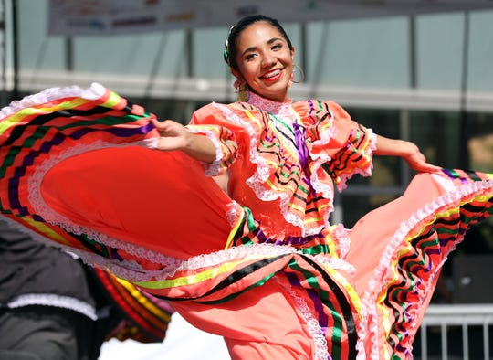 A dancer from the Quad Cities Ballet Folklorico performs during the Iowa Latino Heritage Festival in the Western Gateway Park on Saturday, September 28, 2019 in Des Moines featuring artist displays, cultural booths, children's activities, Latin American cuisine, live music, folkloric dance, and much more at the weekend event.