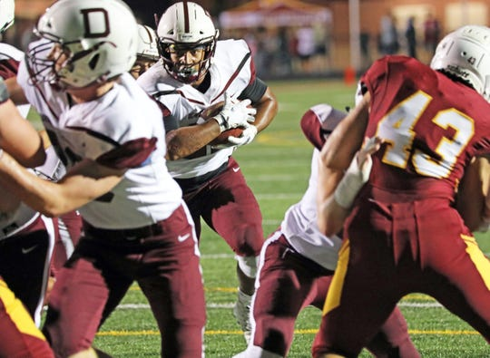 Dowling Catholic senior running back and Iowa commit Gavin Williams (21) heads for the end zone as the six-time defending champion Dowling Catholic Maroons battle against the Ankeny Hawks in the first half of play during the Class 4A game on Friday, September 27, 2019 at Ankeny Stadium.
