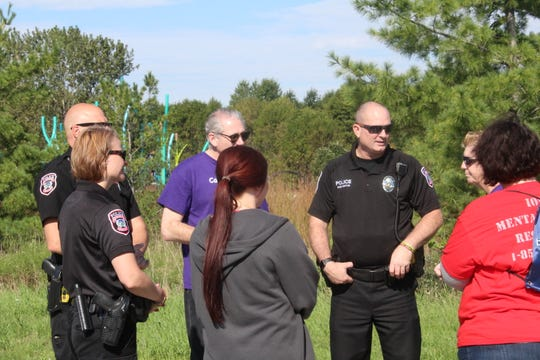 Iowa State Police chief Michael Newton makes mental illness a top priority, having been the president of NAMI Wisconsin and joining the board of NAMI Iowa after moving. He and his officers attended the NAMIWalk Iowa event Saturday morning.