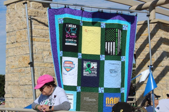 Debbie Rolek said creating this quilt was a way to grieve after losing her son to suicide in July. She attended the NAMIWalk Iowa event in Johnston Saturday morning hoping to get more t-shirts for another quilt.
