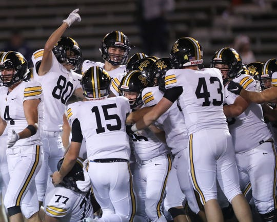 Sep 27, 2019; Ft. Dodge, IA, USA; Southeast Polk kicker Logan Sunvold is swarmed by his team after he kicked a 46 yard field goal as time expires to beat the Ft. Dodge Dodgers at Dodger Stadium. The Rams beat the Dodgers 24-21.