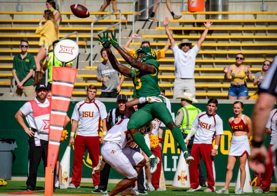 Sep 28, 2019; Waco, TX, USA; Baylor Bears wide receiver Denzel Mims (5) catches a pass for a touchdown over Iowa State Cyclones defensive back Tyler Rodgers (25) during the first half at McLane Stadium.
