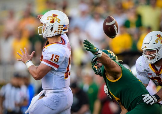 Sep 28, 2019; Waco, TX, USA; Baylor Bears defensive end James Lockhart (9) strips the ball away from Iowa State Cyclones quarterback Brock Purdy (15) to seal the win at McLane Stadium.