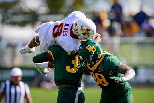Sep 28, 2019; Waco, TX, USA; Iowa State Cyclones wide receiver Deshaunte Jones (8) catches a pass and is upended by Baylor Bears safety Chris Miller (3) and linebacker Jordan Williams (38) during the first half at McLane Stadium.