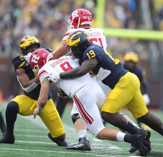 Michigan defensive lineman Kwity Paye sacks Rutgers quarterback Artur Sitkowski during the first half on Saturday, Sept. 28, 2019, at Michigan Stadium.