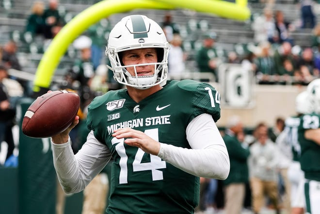 Michigan State quarterback Brian Lewerke warms up before the Indiana game at Spartan Stadium in East Lansing, Saturday, Sept. 28, 2019.