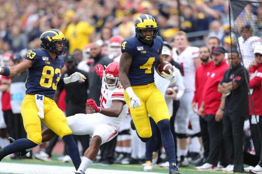 Michigan wide receiver Nico Collins runs by Rutgers defensive back Anthony Marshall for a touchdown during the first half on Saturday, Sept. 28, 2019, at Michigan Stadium.
