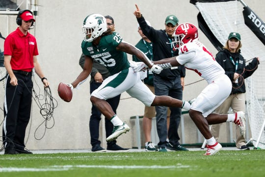 Michigan State receiver Darrell Stewart Jr. makes a catch behind Indiana defensive back Andre Brown Jr. during the first half at Spartan Stadium in East Lansing, Saturday, Sept. 28, 2019.