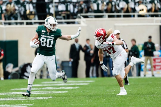 Michigan State's Matt Seybert runs against Indiana defensive lineman Michael Ziemba during the first half at Spartan Stadium in East Lansing, Saturday, Sept. 28, 2019.