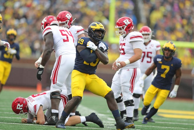 Michigan defensive lineman Quitty Bay fired Rudders quarterback Arthur Sitkovsky in the first half at Michigan Stadium on Saturday, September 28, 2019.