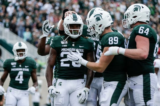 Darrell Stewart Jr. (25) celebrates his touchdown against Indiana in the first half Saturday.