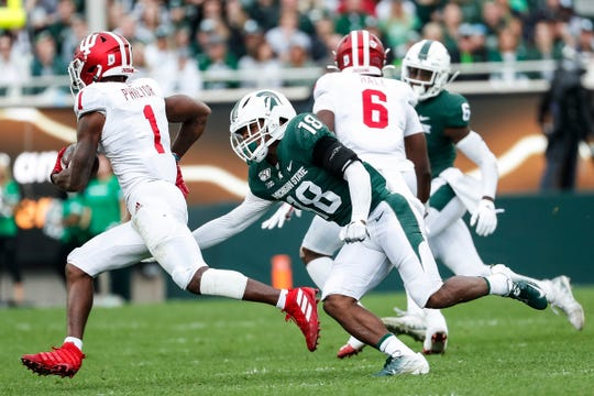 Michigan State cornerback Kalon Gervin tries to tackle Indiana receiver Whop Philyor during the first half at Spartan Stadium in East Lansing, Saturday, Sept. 28, 2019.