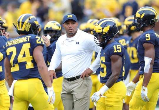 Michigan Wolverines offensive coordinator Josh Gattis on the field before action against the Rutgers Scarlet Knights on Saturday, Sept. 28, 2019, at Michigan Stadium in Ann Arbor.
