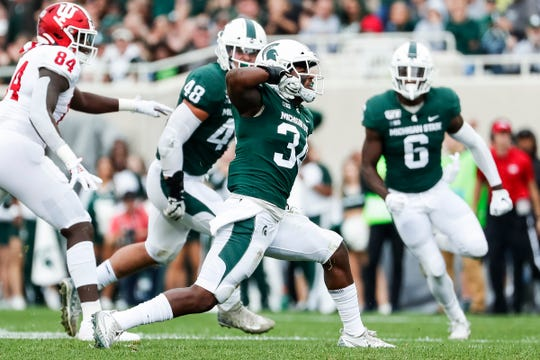 Linebacker Antjuan Simmons (34) is back this fall, but MSU's defense loses eight veteran starters, including defensive end Kenny Willekes (48) and safety David Dowell (6).