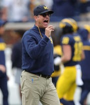 Michigan Wolverines head coach Jim Harbaugh on the field before action against the Rutgers Scarlet Knights on Saturday, Sept. 28, 2019, at Michigan Stadium in Ann Arbor.