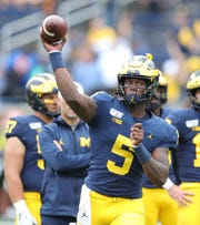 Michigan Wolverines quarterback Joe Milton (5) warms up before action against the Rutgers Scarlet Knights on Saturday, Sept. 28, 2019, at Michigan Stadium in Ann Arbor.