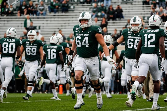 Michigan State offensive lineman Matt Allen (64) warms up before the Indiana game at Spartan Stadium in East Lansing, Saturday, Sept. 28, 2019.