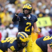 Michigan quarterback Shea Patterson calls a play against Rutgers during the first half on Saturday, Sept. 28, 2019, at Michigan Stadium.