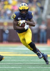 Michigan running back Hassan Haskins runs the ball during the second half of U-M's 52-0 win over Rutgers on Saturday, Sept. 28, 2019, at Michigan Stadium.