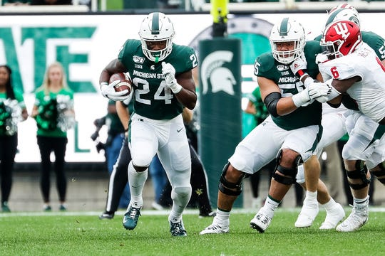 Michigan State running back Elijah Collins runs against Indiana during the first half at Spartan Stadium in East Lansing, Saturday, Sept. 28, 2019.