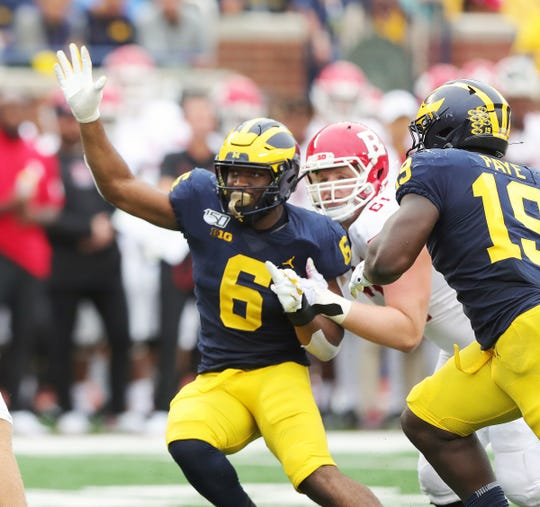 Michigan linebacker Josh Uche rushes against Rutgers quarterback Artur Sitkowski during the second half of U-M's 52-0 win on Saturday, Sept. 28, 2019, at Michigan Stadium.