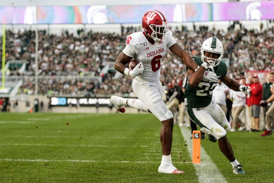 Indiana receiver Donavan Hale scores a touchdown against Michigan State cornerback Josiah Scott early in the fourth quarter at Spartan Stadium.