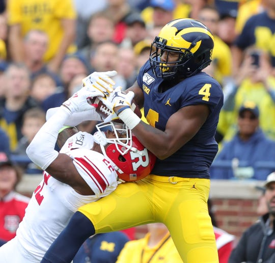 Rutgers defensive back Damon Hayes makes the interception in front of Michigan wide receiver Nico Collins during the second half of U-M's 52-0 win on Saturday, Sept. 28, 2019, at Michigan Stadium.