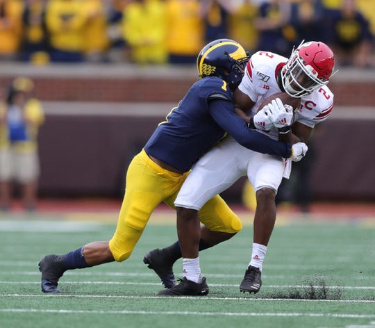 Michigan defensive back Ambry Thomas tackles Rutgers running back Raheem Blackshear during the second half of U-M's 52-0 win on Saturday, Sept. 28, 2019, at Michigan Stadium.